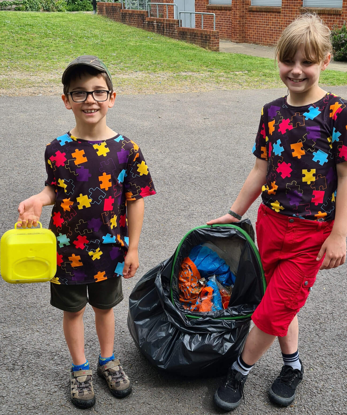 bibic-girl-with-brother-litter-picking